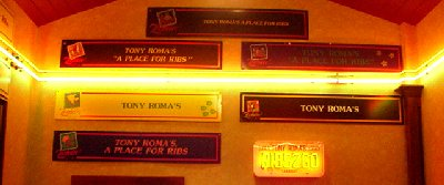 The colorful entrance to Tony Roma's featuring Zoobilee signs.