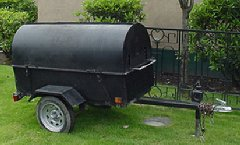 Barbeque Grill & Trailer by the Tony Roma's entrance.